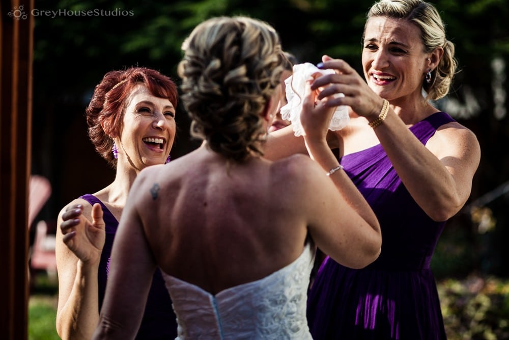 bride sees groom for first look and cries photo