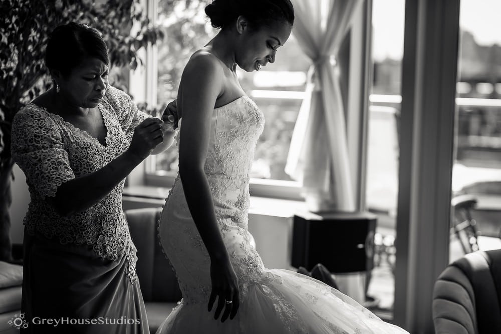 nyc east village wedding photos bride putting on dress with mom